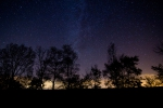 The Milkyway above the Lowland forest in Lower Austria. It was full moon, but thanks to the lunar eclipse the stars were shining bright.